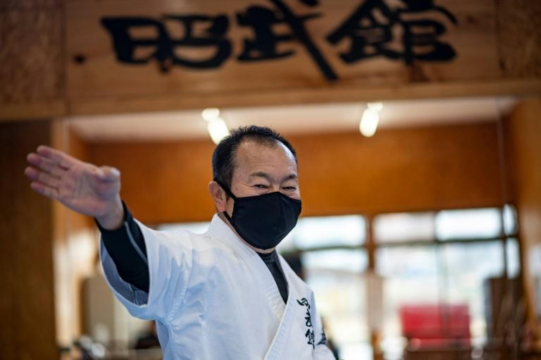 Karate teacher Kazuo Okano is hoping to take part in the rescheduled torch relay