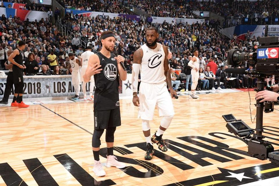 Stephen Curry and LeBron James address the crowd at the 2018 NBA All-Star Game. (Getty Images)ry