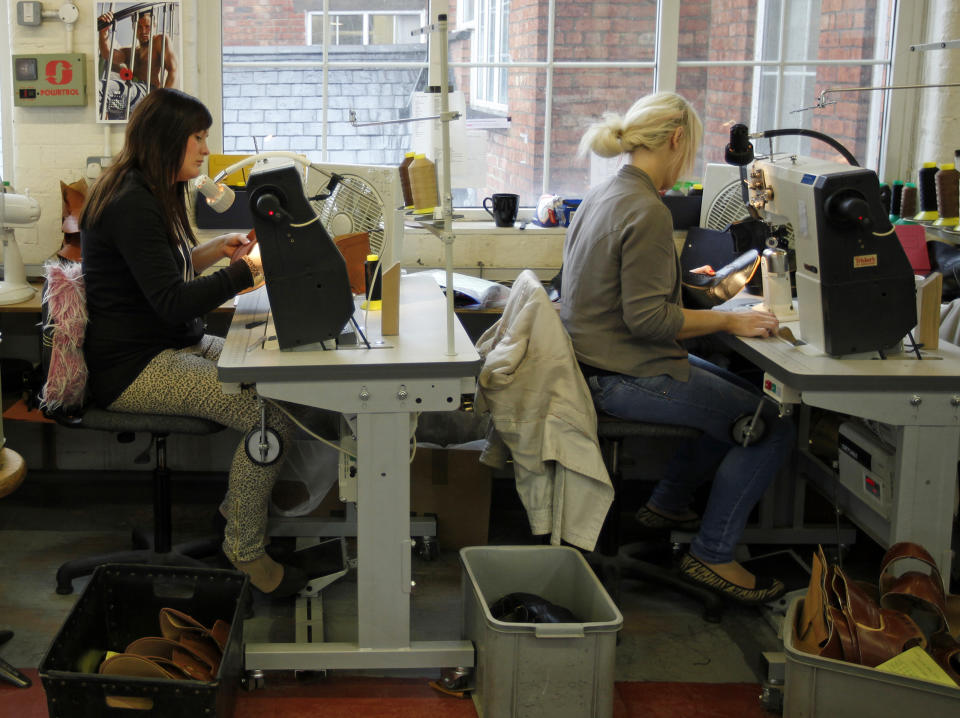 Workers sew shoes at the Tricker's shoe factory in Northampton, central England. Photo: Darren Staples/Reuters