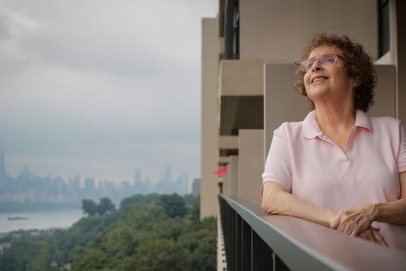 Laura Gross looks out from her balcony in Fort Lee, New Jersey
