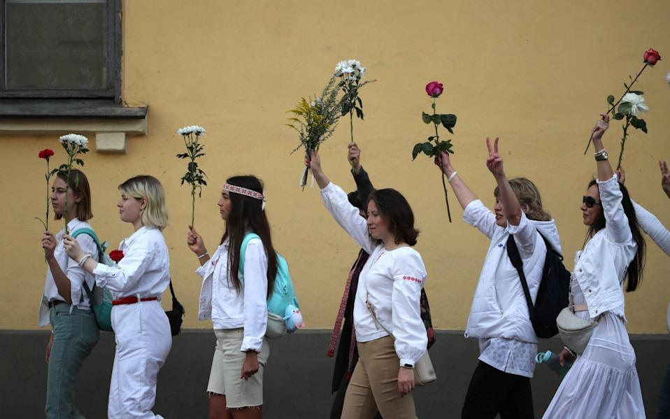 Women holding flowers rallied in support of protesters detained and injured following the disputed election - Tatyana Zenkovich/EPA-EFE