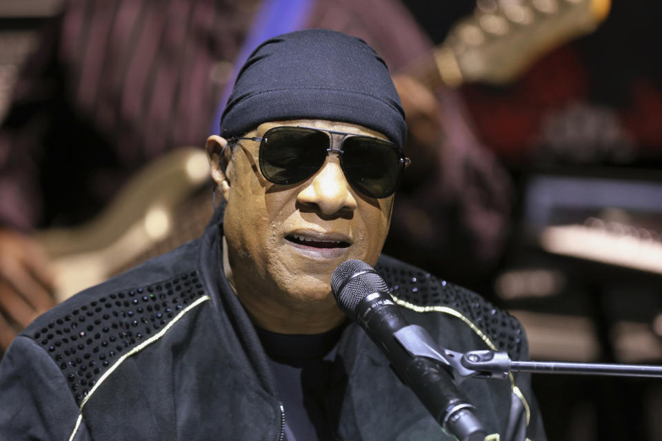 """FILE - In this Nov. 27, 2018, file photo, Stevie Wonder performs live at a news press conference for the """"House Full of Toys 22nd annual Benefit Concert"""" in Los Angeles. Stevie Wonder is back in his home state of Michigan to get out the vote for Joe Biden, Saturday, Oct. 31, 2020. """"The only way we're gonna win this fight, a fight against injustice, is by voting,"""" he told a crowd gathered at a drive-in rally in Detroit. (Photo by Willy Sanjuan/Invision/AP, File)"""