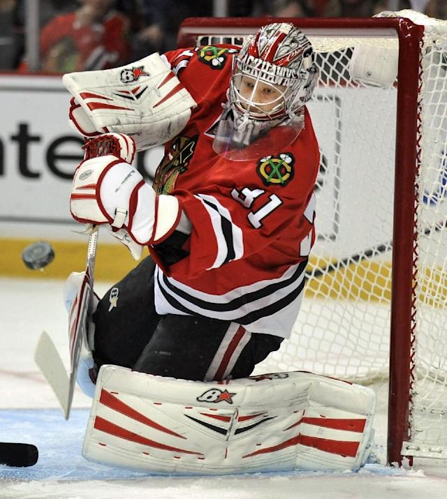 Chicago Blackhawks goalie Antti Raanta makes a save during the first period of an NHL hockey game against the Edmonton Oilers in Chicago, Sunday, Jan., 12, 2014. (AP Photo/Paul Beaty)