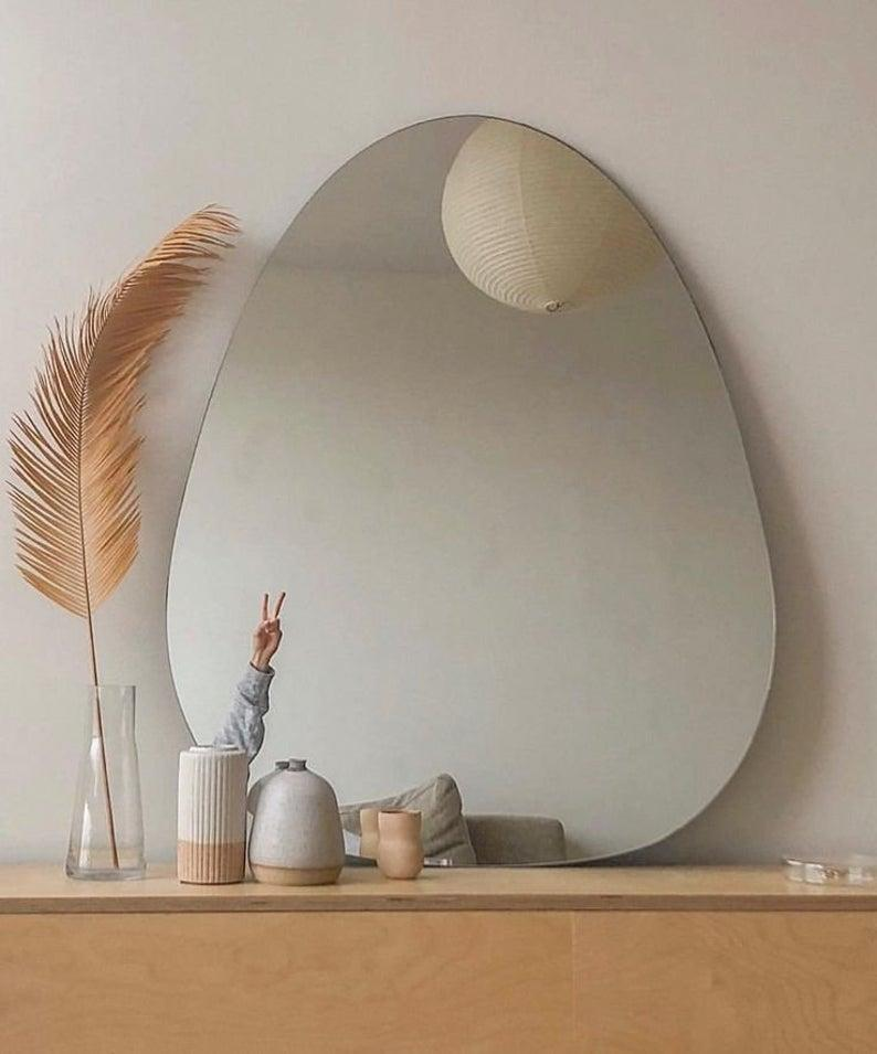 <p>Place this statement <span>Asymmetrical Mirror</span> ($224 and up, originally $299 and up) on your dresser.</p>