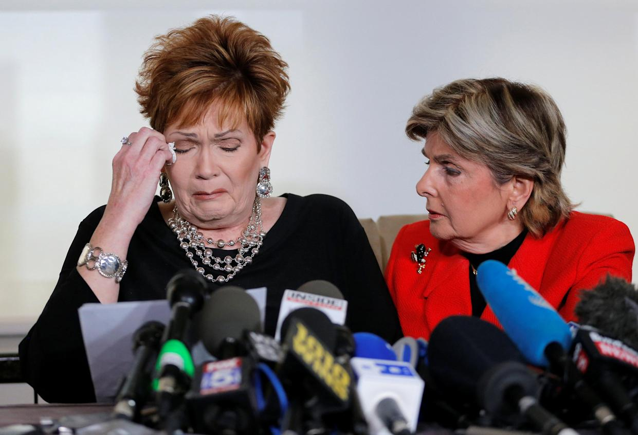 Attorney Gloria Allred, right, comforts Beverly Nelson at a press conference in New York City on Monday. (Photo: Lucas Jackson/Reuters)