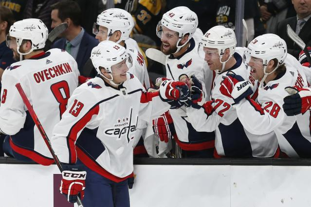 Washington Capitals' Jakub Vrana (13) celebrates his goal in the shootout of the team's NHL hockey game against the Boston Bruins in Boston, Saturday, Nov. 16, 2019. (AP Photo/Michael Dwyer)