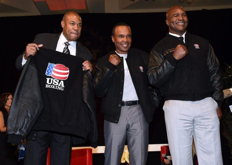 George Foreman Jr., Sugar Ray Leonard and Evander Holyfield in 2014. (Getty Images)