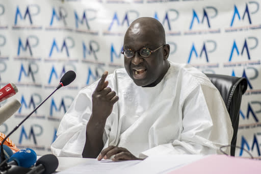 Papa Massata Diack, son of Lamine Diack the former president of the International Association of Athletics Federations (IAAF) now known as World Athletics, speaks at a press conference in Dakar, Senegal Monday, Sept. 14, 2020. The son of the former head of world track and field's governing body again denounced the corruption and money laundering charges against himself and his father Monday, with a verdict in the trial in France expected to be delivered on Wednesday. (AP Photo/Sylvain Cherkaoui)