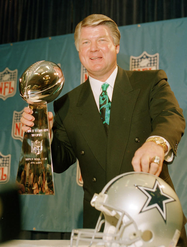 FILE - In this Jan. 28, 1994, file photo, Dallas Cowboys head coach Jimmy Johnson poses with the Vince Lombardi Super Bowl trophy during an NFL football news conference in Atlanta. Five Super Bowl-winning coaches, including Johnson, and such NFL champion players as Roger Craig, Drew Pearson and Donnie Shell are among the finalists for the Pro Football Hall of Fame's special centennial class announced Thursday, Dec. 19, 2019. A 25-member panel of pro football experts is charged with selecting 10 senior players, two coaches and three contributors who will be inducted into the Canton, Ohio shrine next year as part of the league's celebration of its 100th season. (AP Photo/Ron Heflin, File)