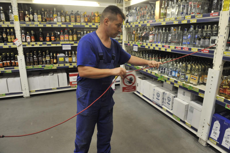 Using the No Entry sign, an employee closes the liquor department in Makro hypermarket in Ostrava, Czech Republic, late Friday, Sept. 14, 2012. The Czech authorities took an unprecedented emergency measure today and banned the sale of spirits with more than 20 percent alcohol content as it battles a wave of methanol poisonings that has already killed 19 people. (AP Photo/CTK, Jaroslav Ozana) SLOVAKIA OUT