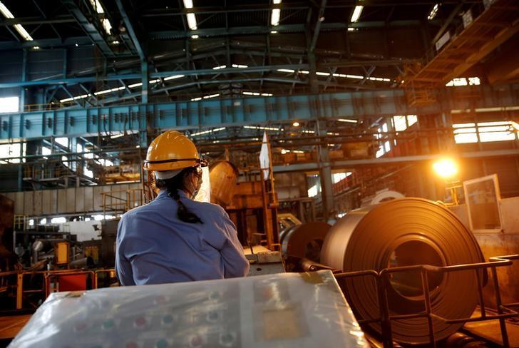 FILE PHOTO: A worker moves a roll of steel using a remote control inside the China Steel Corporation factory in Kaohsiung