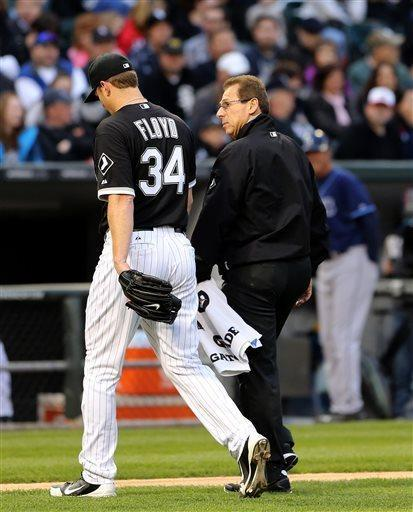 Chicago White Sox starting pitcher Gavin Floyd leaves the game with trainer Herm Schneider in the third inning after an injury against the Tampa Bay Rays in a baseball game in Chicago on Saturday, April 27, 2013. (AP Photo/Charles Cherney)