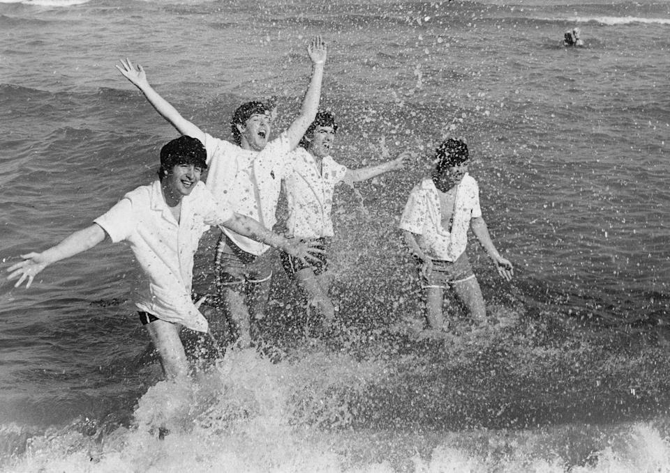 <p>English pop group The Beatles frolicking in the surf at Miami Beach, Florida. <br></p><p>Other celebrity visitors this year: Frank Sinatra, Muhammad Ali.</p>