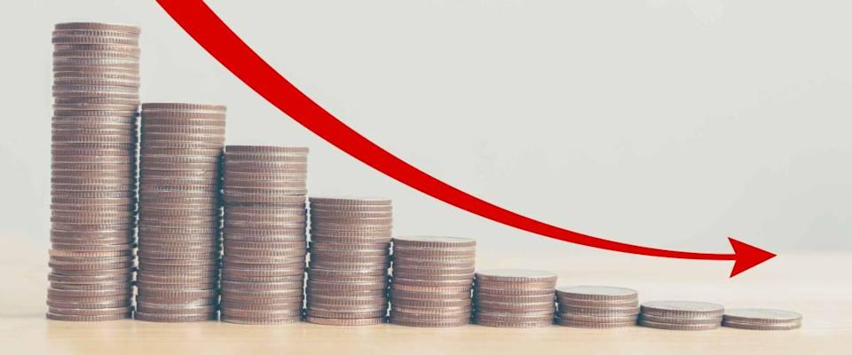 Coin stack step down graph with red arrow and percent icon, Risk management business financial and managing investment percentage interest rates concept
