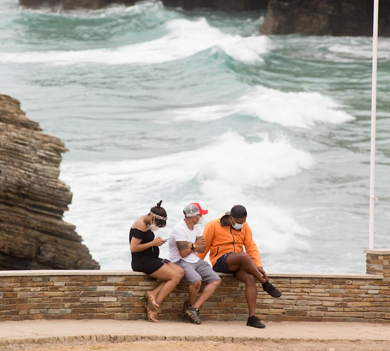 LUGO, SPAIN - JULY 05: Citizens are seen at Las Catedrales beach, in the Galician region of A Mariña at Lugo, which will be closed for five days after a coronavirus outbreak that affects more than a hundred people declared, on July 05, 2020 in Lugo, Spain. (Photo by Carlos Castro/Europa Press via Getty Images)