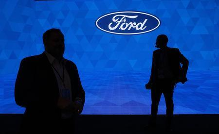 FILE PHOTO: Workers prepare for the Ford Motor Company 2019 reveal at the North American International Auto Show in Detroit, Michigan, U.S., January 14, 2019. REUTERS/Jonathan Ernst