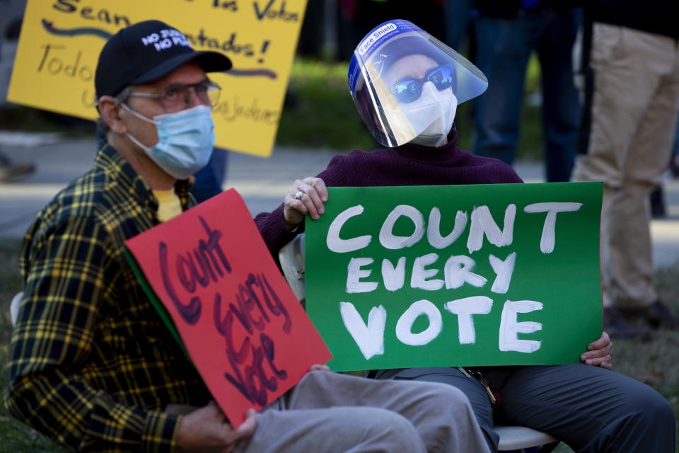 People rally to demand all votes are counted the day after election day. Source: AAP