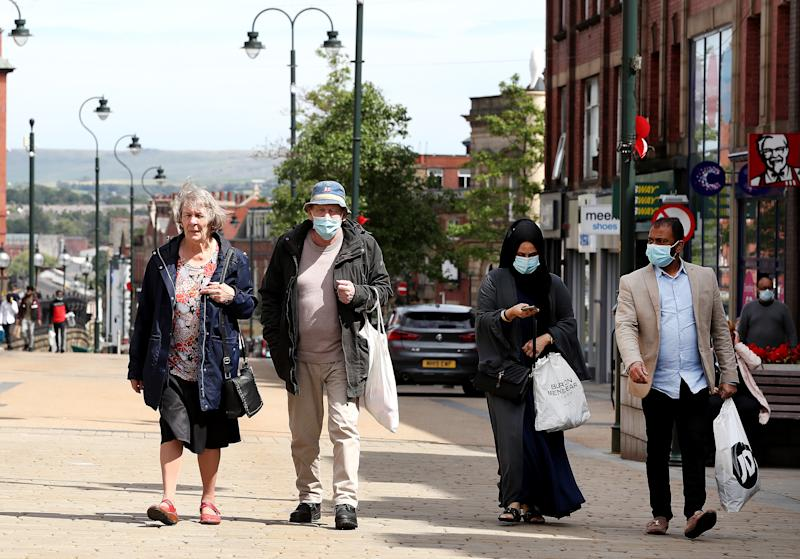 People shopping in Oldham, which is currently seeing the highest number of daily coronavirus infections in England. (PA)