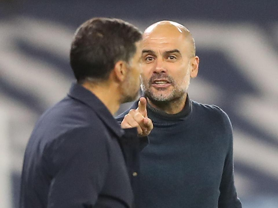 Pep Guardiola and Sergio Conceicao (POOL/AFP via Getty Images)
