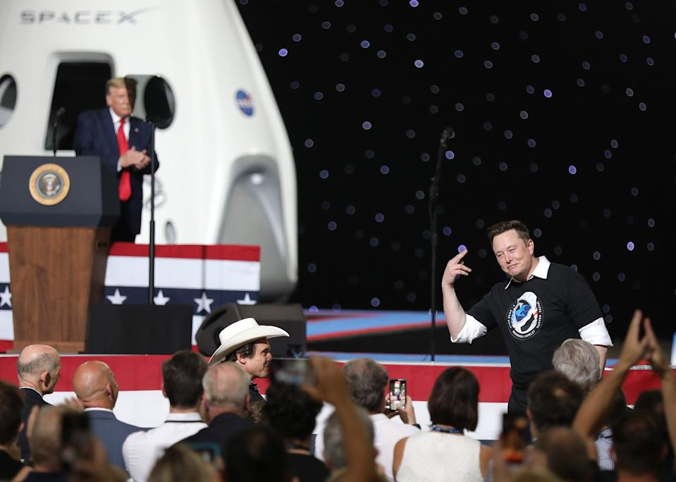 CAPE CANAVERAL, FLORIDA - MAY 30: U.S. President Donald Trump acknowledges Spacex founder Elon Musk (R) after the successful launch of the SpaceX Falcon 9 rocket with the manned Crew Dragon spacecraft at the Kennedy Space Center on May 30, 2020 in Cape Canaveral, Florida. Earlier in the day NASA astronauts Bob Behnken and Doug Hurley lifted off an inaugural flight and will be the first people since the end of the Space Shuttle program in 2011 to be launched into space from the United States. (Photo by Joe Raedle/Getty Images)
