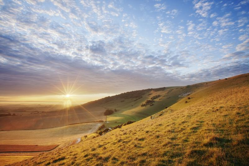 Sunrise over chalk downland viewed from Wilmington Hill, Wilmington, South Downs National Park, East Sussex