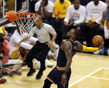 Apr 20, 2017; Indianapolis, IN, USA; Cleveland Cavaliers forward LeBron James (23) dunks against the Indiana Pacers in game three of the first round of the 2017 NBA Playoffs at Bankers Life Fieldhouse. Cleveland defeats Indiana 119-114. Mandatory Credit: Brian Spurlock-USA TODAY Sports
