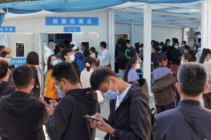 People line up for nucleic acid testing at a hospital in Yantai