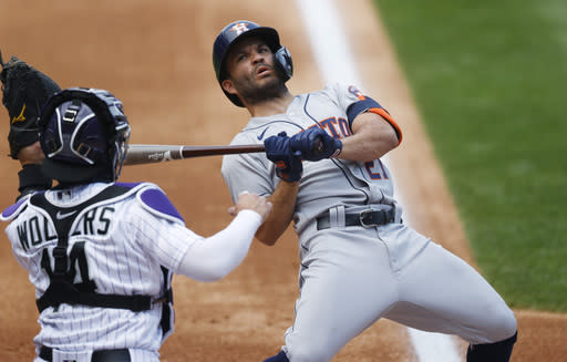 Houston Astros' Jose Altuve, right, reacts to a high inside pitch as Colorado Rockies catcher Tony Wolters pulls in the throw in the second inning of a baseball game Thursday, Aug. 20, 2020, in Denver. (AP Photo/David Zalubowski)