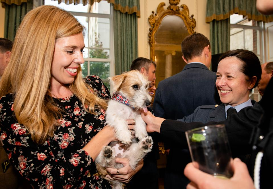 Carrie Symonds opted for a black and red floral dress as she introduced her new pup to guests at No.10 [Photo: Getty Images]