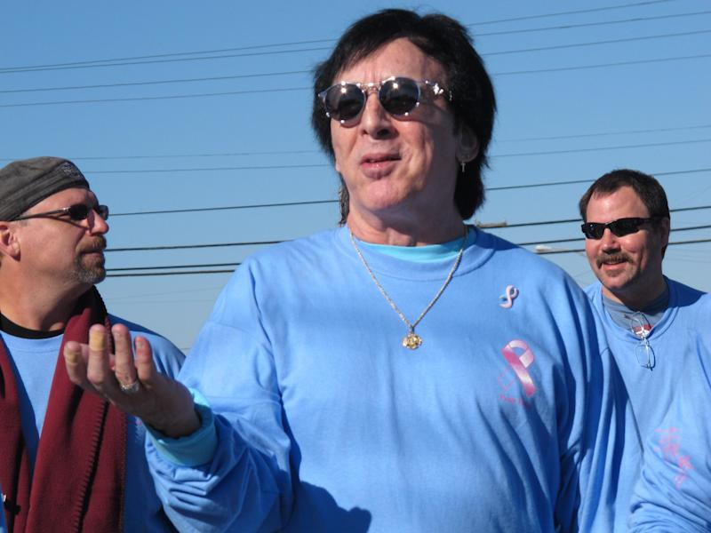FILE- In this Oct. 21, 2012 file photo, original Kiss drummer Peter Criss walks in a walkathon to raise money for breast cancer research in Point Pleasant Beach N.J. But the band said on Sunday, Feb. 23, 2014 it has decided not to perform at the April 10, 2014 induction ceremony after a dispute over which lineup would play. The dispute concerns whether original members Ace Frehley and Criss would join Gene Simmons and Paul Stanley in a live performance, or whether the current lineup of Stanley, Simmons, Eric Singer and Tommy Thayer would play. (AP Photo/Wayne Parry, File)