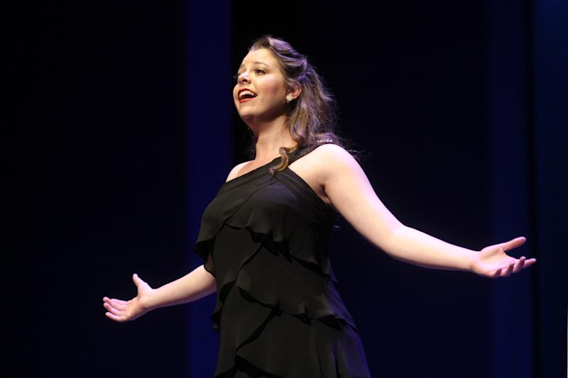 This June 25, 2012 photo released by The Jimmy Awards shows Elizabeth Romero, 18, from Fullerton, Calif., performing at the Minskoff Theatre in New York. Romero and Joshua Grosso, 18, from Tampa, Fla., were named best actress and best actor at the fourth annual National High School Musical Theater Awards, nicknamed the Jimmy Awards after theater owner James Nederlander. Both received $10,000 scholarship awards, capping a months-long winnowing process that began with 50,000 students from 1,000 schools. Sixty finalists were invited to New York to compete for the title and make their Broadway debuts on the Minskoff Theatre stage. (AP Photo/The Jimmy Awards, Henry McGee)