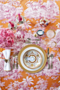 """<p>""""Easter brunch is a fun and festive occasion, and while the typical bunny and egg themed decor is great, you can always up the level of sophistication by incorporating luxurious (and colorful!) fabrics into a decorative table. Manuel Canovas gave an edge to this traditional toile with a fabulous fuchsia/orange color combination."""" <em>—<a href=""""http://www.annehepfer.com/"""" rel=""""nofollow noopener"""" target=""""_blank"""" data-ylk=""""slk:Anne Hepfer"""" class=""""link rapid-noclick-resp"""">Anne Hepfer</a>, Interior Designer</em></p>"""