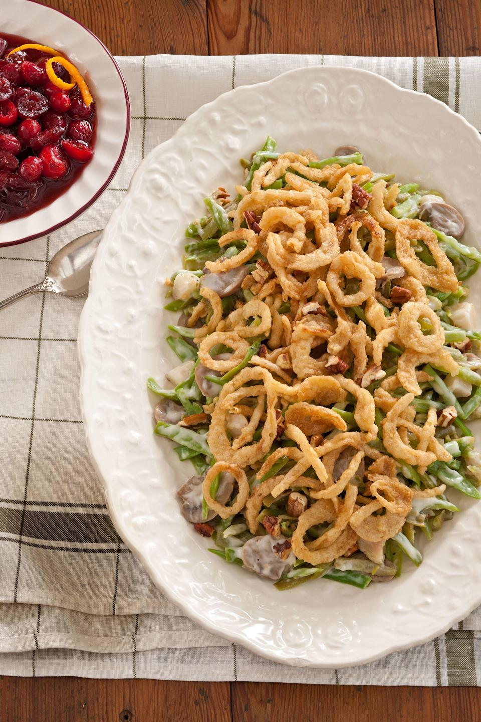 """<p><strong>Recipe: <a href=""""http://www.myrecipes.com/recipe/green-bean-casserole-0"""" rel=""""nofollow noopener"""" target=""""_blank"""" data-ylk=""""slk:Green Bean Casserole"""" class=""""link rapid-noclick-resp"""">Green Bean Casserole</a></strong></p> <p>Go beyond the standard """"recipe on the can"""" casserole by adding Alfredo sauce instead of cream of mushroom soup, water chestnuts, Parmesan cheese, and toasted pecans.</p>"""