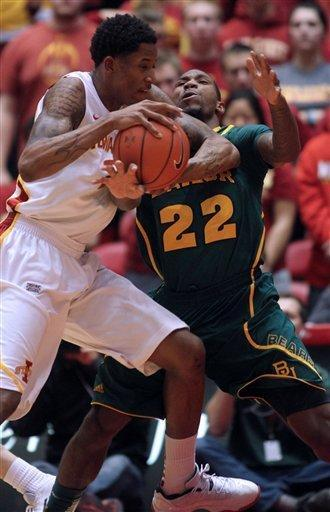 Iowa State guard Will Clyburn (21) runs into Baylor guard A.J. Walton (22) in the first half of an NCAA college basketball game Saturday, Feb. 2, 2013, at Hilton Coliseum in Ames, Iowa. Clyburn was called for a foul on the play. (AP Photo/Justin Hayworth)