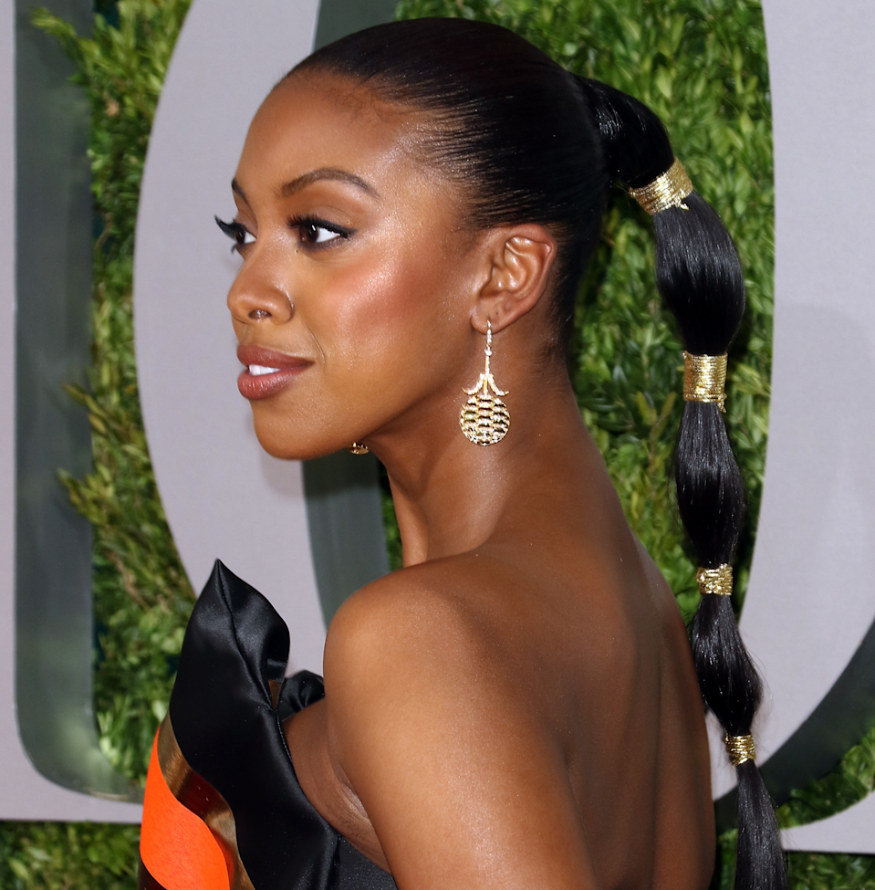 Create a bubble-ponytail effect by wrapping your hair in four sections with gold thread, wire, or string.