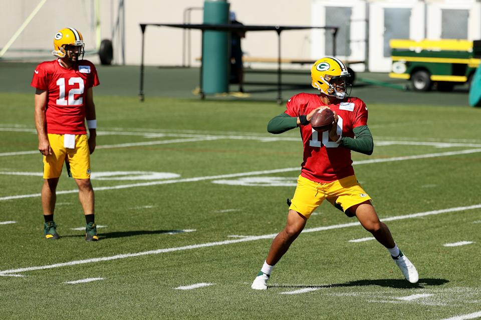 Jordan Love (10) of the Green Bay Packers participates in a drill as Aaron Rodgers looks on. (Photo by Dylan Buell/Getty Images)