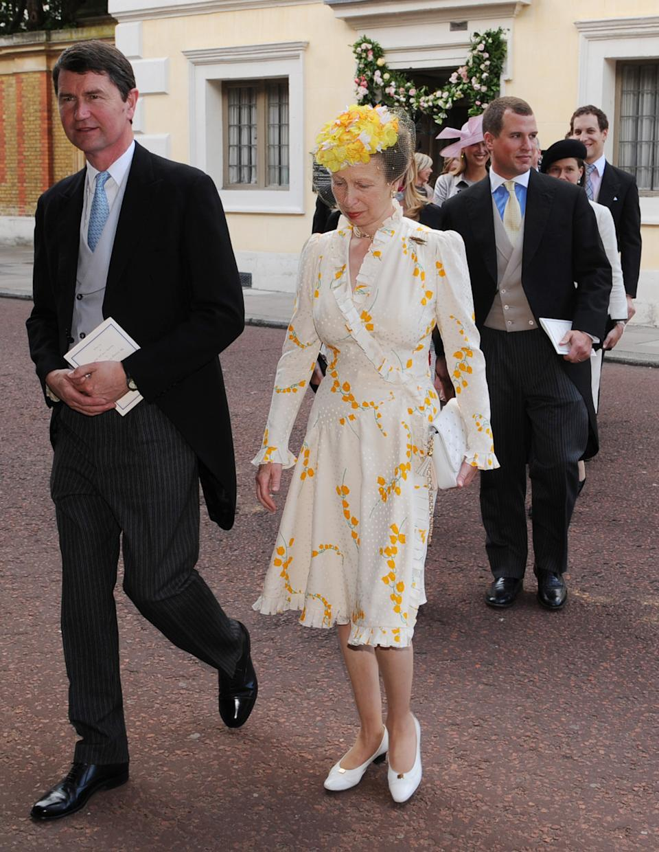 <p>Princess Anne wore this yellow summery dress to a royal wedding in 2008, and it was a rewear then - so perhaps now's the time to bring it back once more. (Stefan Rousseau/PA Wire)</p>