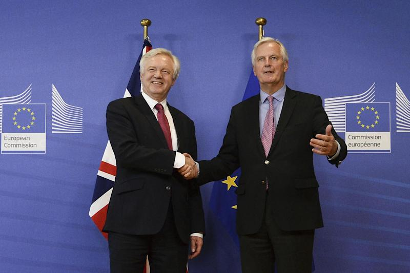 Brexit: Davis Davis shakes hands with the European Union's chief negotiator Michel Barnier: AFP/Getty Images