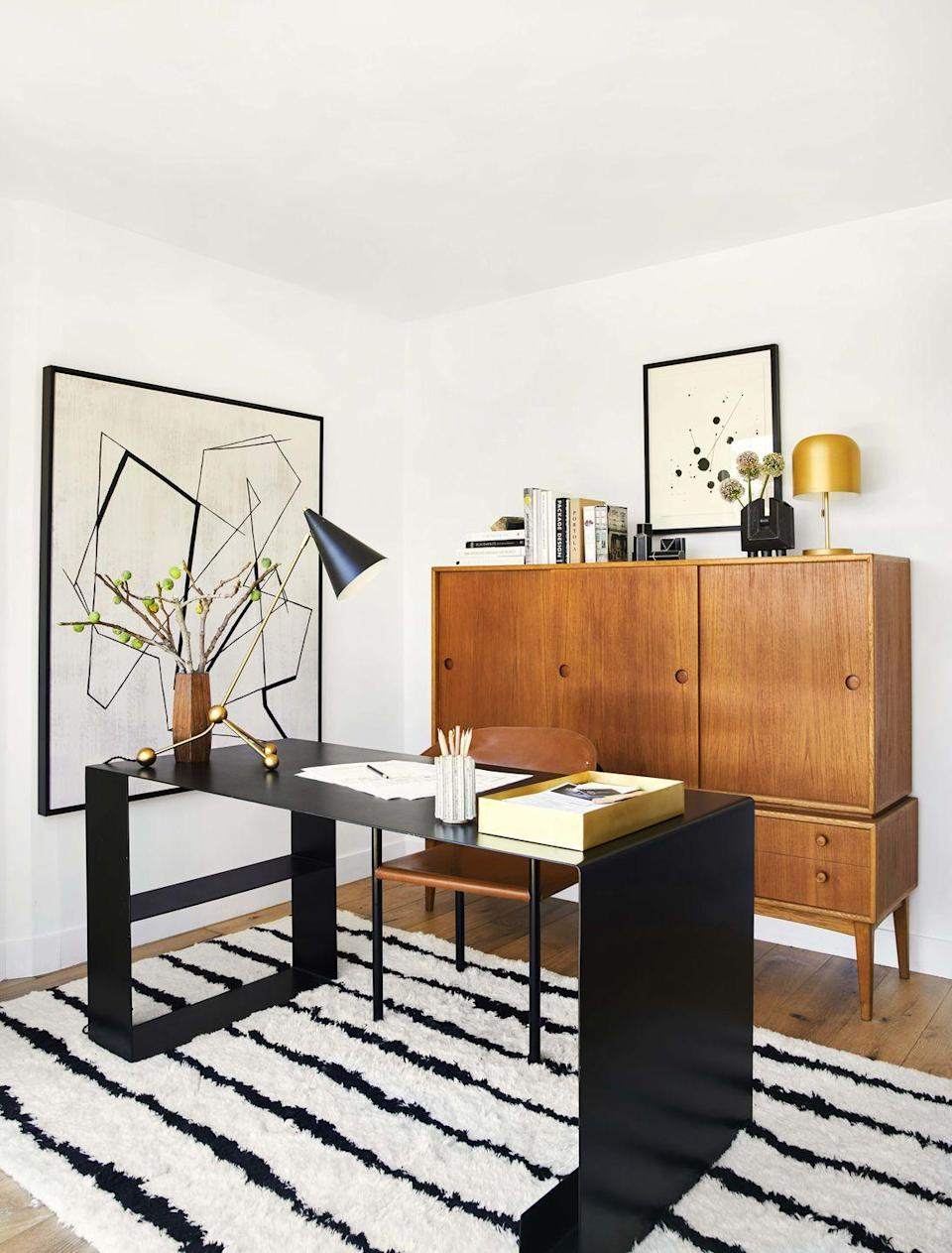 """<p>Tasked with turning a tiny, white-walled bedroom in <a href=""""https://www.housebeautiful.com/design-inspiration/celebrity-homes/a30696940/bobby-berk-home-office/"""" rel=""""nofollow noopener"""" target=""""_blank"""" data-ylk=""""slk:Bobby Berk's Los Angeles home"""" class=""""link rapid-noclick-resp"""">Bobby Berk's Los Angeles home</a> into a proper home office, creative director Brady Tolbert headed to Craigslist to find the perfect mid-century credenza. It's not just all looks—the cabinet keeps messy papers out of sight.</p>"""