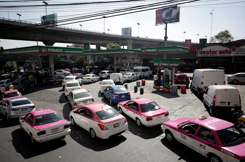 FILE PHOTO: Cars are seen lined-up to buy fuel at a gas station in Mexico City