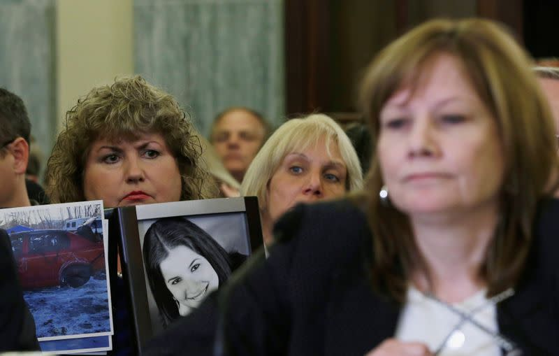 FILE PHOTO: Theresa Ruddy holds pictures as General Motors CEO Barra testifies before Senate Commerce and Transportation Consumer Protection, Product Safety and Insurance subcommittee in Washington