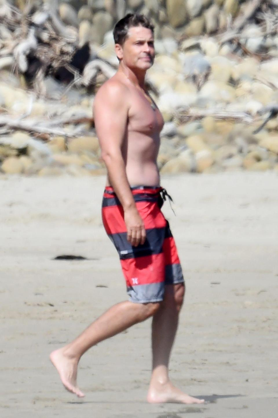 <p>Rob Lowe enjoys a beach day with his son Matthew in Santa Barbara on Saturday.</p>