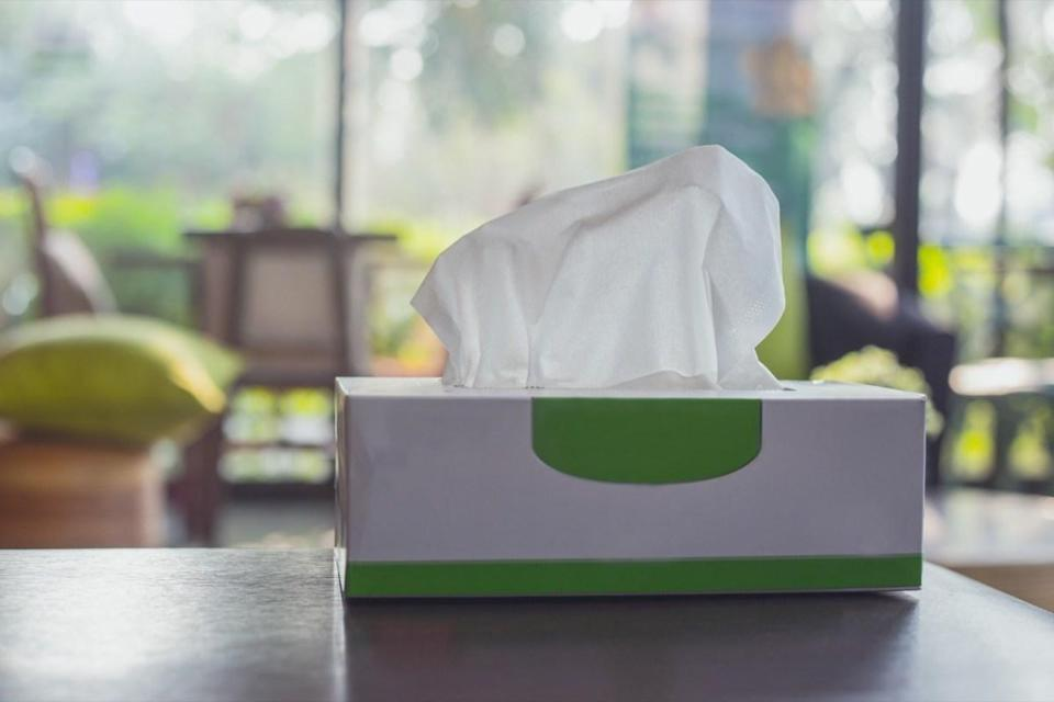 Tissue box on wooden table at home. Tissue paper for cleaning