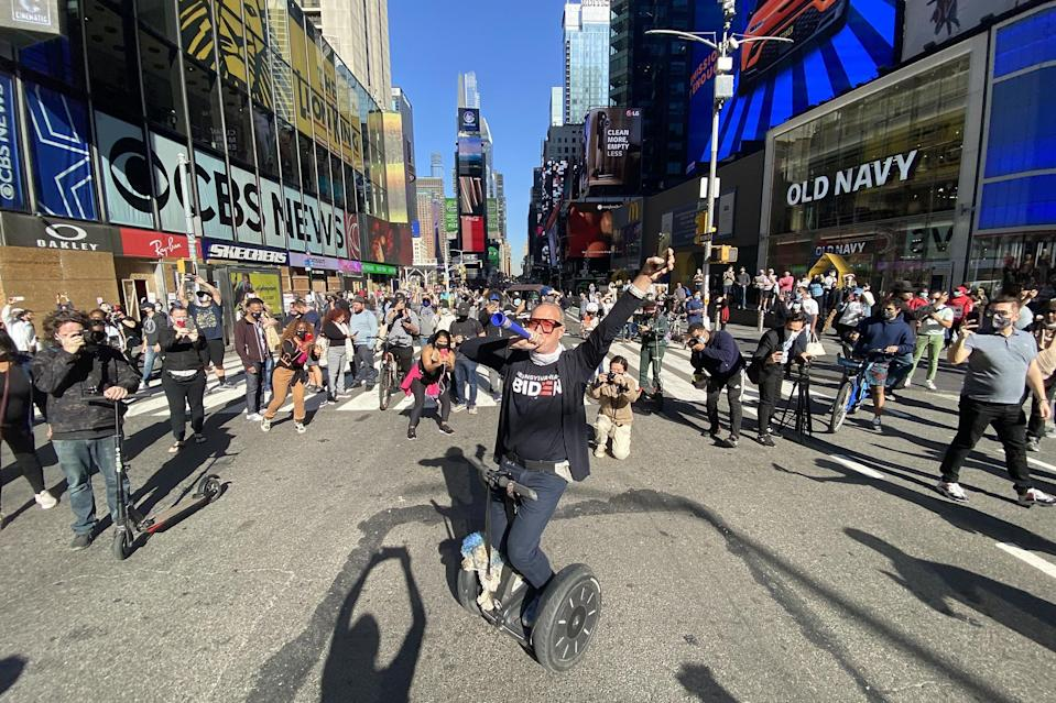 <p>People celebrated in Times Square on Saturday after Biden was projected as the winner of the election.</p>