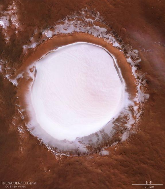 , Moody photo from Mars shows a giant crater loaded with ice