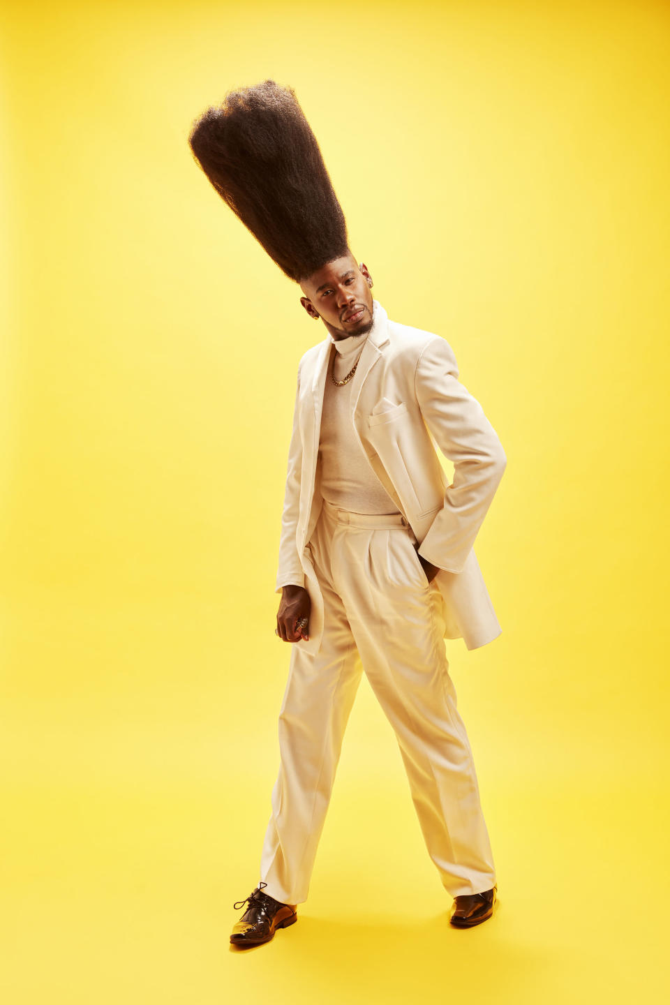 <p>Benny Harlem must have been growing his hair for a while, with a length of 52cm (20.5 inches). </p>