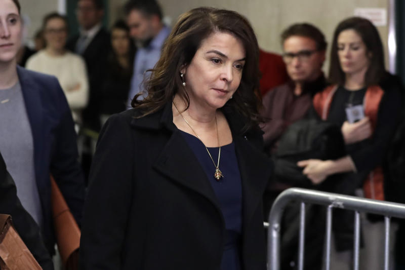 FILE - In this Thursday, Jan. 23, 2020 file photo, actress Annabella Sciorra returns after a lunch break in Harvey Weinstein's rape trial in New York. (AP Photo/Richard Drew)