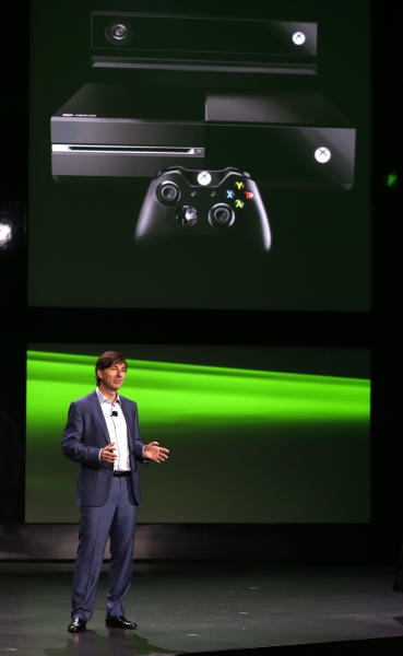 FILE - In a May 21, 2013, file photo Don Mattrick, president of interactive entertainment business for Microsoft Corp., speaks after unveiling the next-generation Xbox One entertainment and gaming console system in Redmond, Wash. With the world's attention, the Electronic Entertainment Expo in Los Angeles in June could also serve as the ultimate opportunity for Microsoft to address concerns over the connectivity and privacy of the new system. (AP Photo/Ted S. Warren, file)
