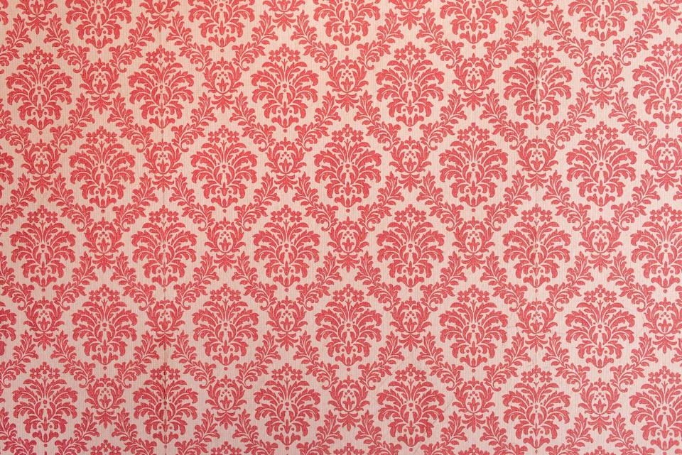 """<p>Is it a floral? Is it chintz? No, it's damask, which was a pattern found on everything from wallpaper to curtains in the 90s. If you still have this in your home, try an update of <a href=""""https://www.elledecor.com/design-decorate/room-ideas/a8673869/floral-print-modern-house/"""" rel=""""nofollow noopener"""" target=""""_blank"""" data-ylk=""""slk:large, statement blooms instead"""" class=""""link rapid-noclick-resp"""">large, statement blooms instead</a>. </p>"""