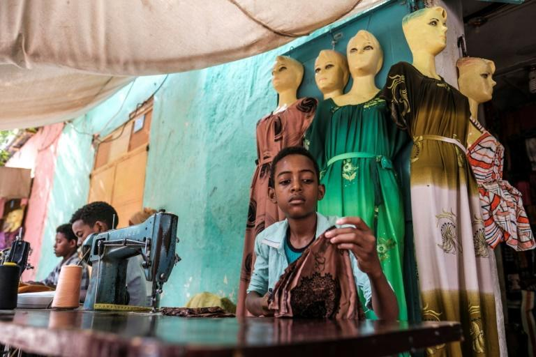 Boys work as tailors in a market in the Tigrayan city of Humera